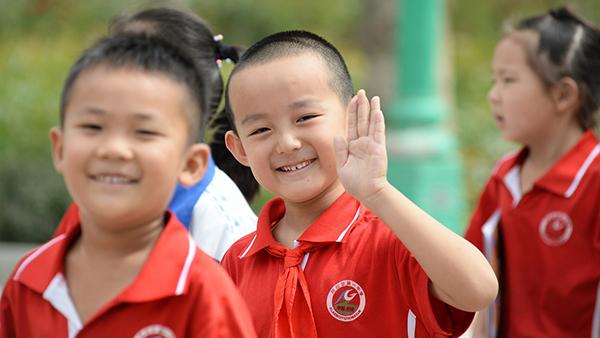 新疆下月将实行从幼儿园到高中15年免费教育