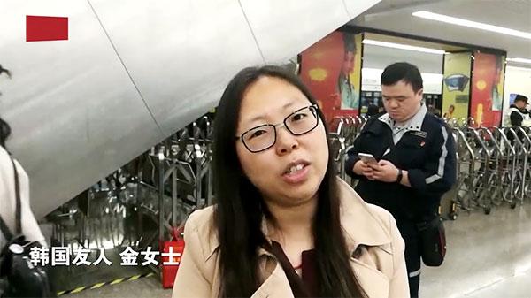 进博会首日街访:韩语女教师直言对进博会很期待