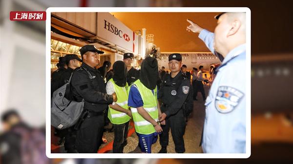 视频 | 57名犯罪嫌疑人集中押解回沪!五地联动捣毁电诈集团